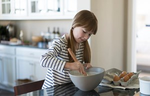 Girl baking in new home in Anthem, Broomfield CO