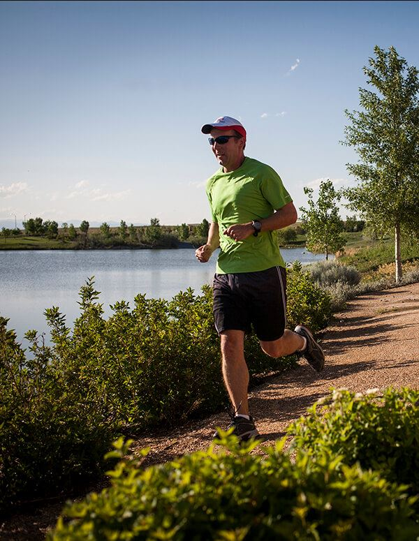 Man on trail in Anthem Master-planned community Broomfield, CO
