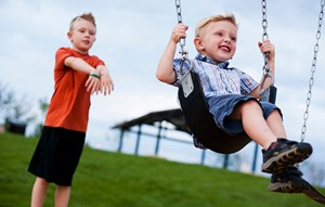 Boys playing in playground in Anthem community Broomfield, CO