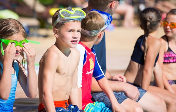 Kids swimming in Camp Anthem Summer Camp in Broomfield Colorado