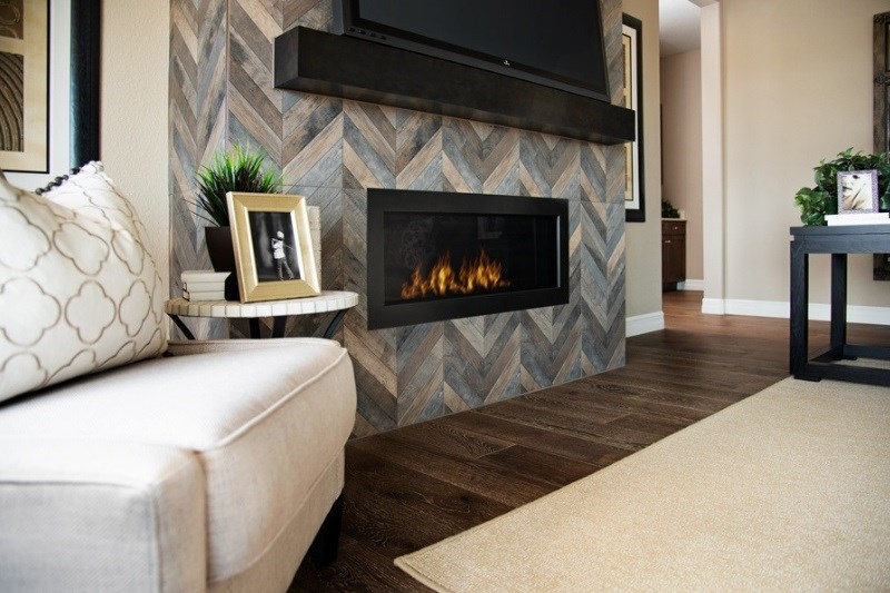 Dayton, a Beautiful Colorado Model New Home family room fireplace by Richmond American in Anthem